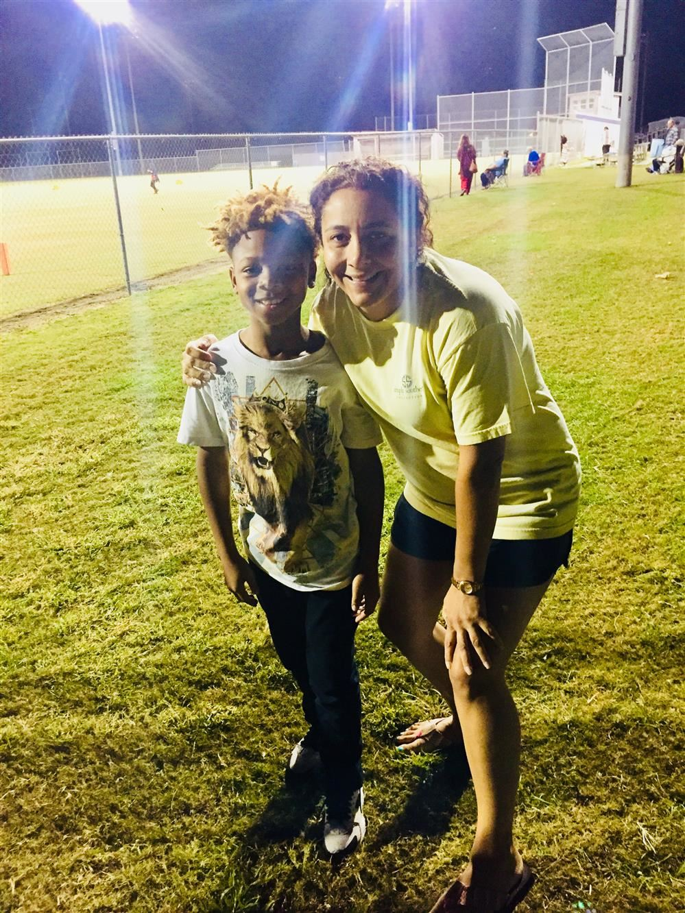 Laphabion and Mrs. Kelly at the fall football rec league championship game.